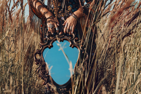 close up of young woman hands holding mirror outdoors Reklamní fotografie
