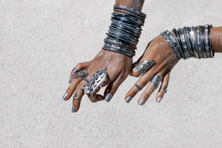 close up of beautiful tribal woman. Hands of ethnic dancer