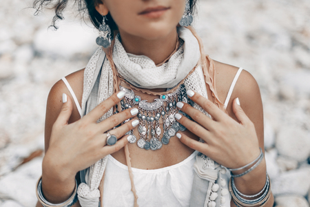 close up of boho styled woman on tropical beach with white pebble Reklamní fotografie - 89336004