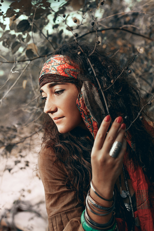 beautiful young gypsy style woman outdoors portrait