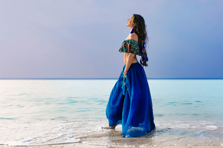 beautiful young stylish woman in blue skirt on the beach Reklamní fotografie