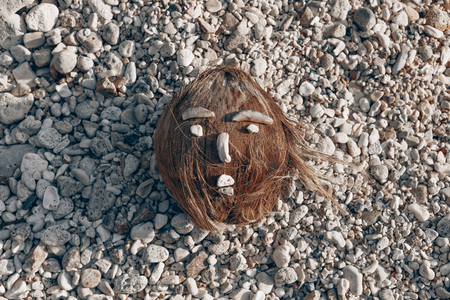 coconut face made of sea shells on the beach
