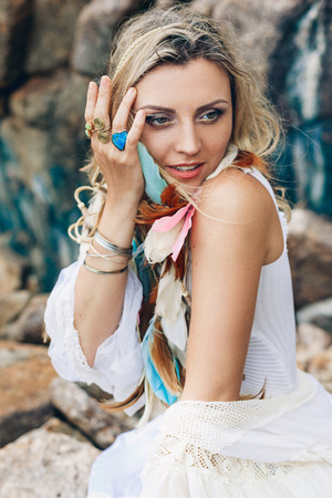 beautiful young boho style woman in white dress