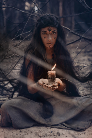 woman holding candle in hands close up Archivio Fotografico