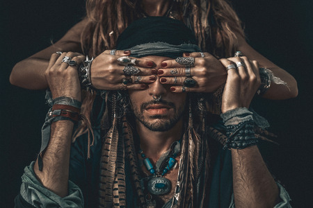 stylish fashionable young handsome man and woman covering his eyes with hands. fashion concept Stockfoto