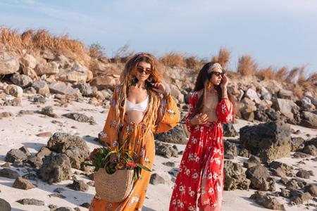two beautiful stylish boho models outdoors