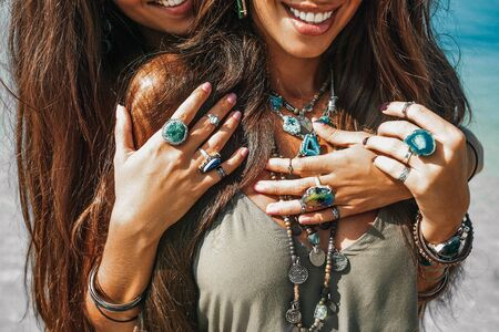 close up of two cheerful stylish women twin sisters having fun outdoors