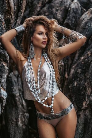 close up of woman boho bikini with stylish accessories on sea background Standard-Bild - 143115019