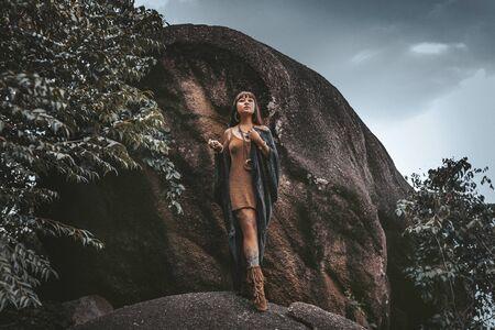 beautiful young stylish tribal style woman outdoors