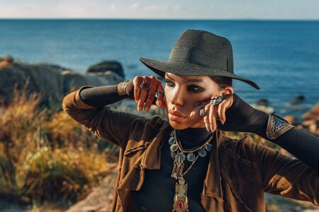 beautiful young fashionable woman outdoors at sunset