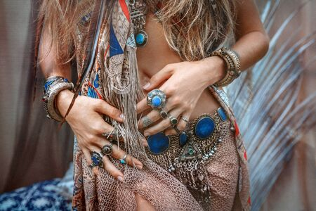 close up of beautiful young gypsy style woman with lots of accessories