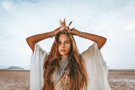 beautiful young stylish woman with boho accessories at sunset Reklamní fotografie