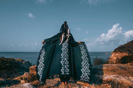 beautiful young stylish tribal style woman outdoors Standard-Bild