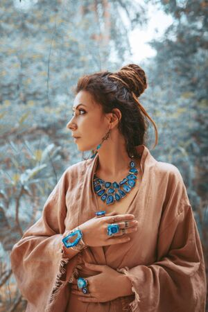 beautiful young woman with gem stones accessories outdoors portrait
