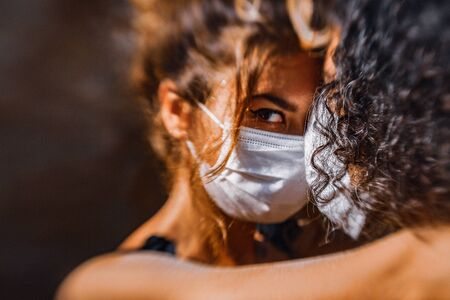 young couple hugging portrait wear face masks and medical gloves