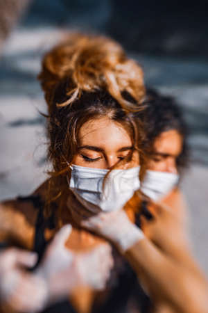 young couple hugging wear face masks and medical gloves