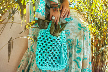 white stylish boho bag close up at tropical background Reklamní fotografie