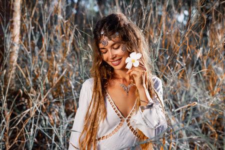 beautiful young woman with frangipani portrait