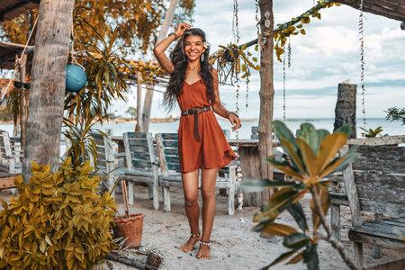 beautiful young stylish woman model posing at tropical resort