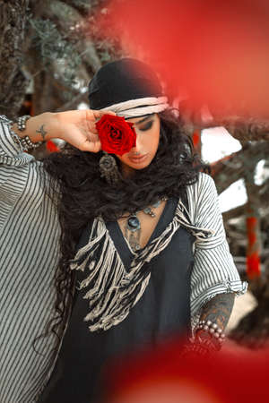 beautiful young gypsy style woman outdoors close up