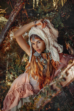beautiful young stylish wuman wearing turban outdoors