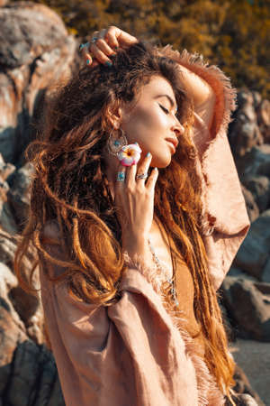 beautiful young woman outdoors portrait at sunset