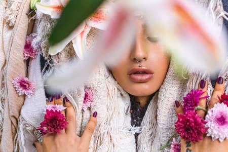 beautiful young woman close up conceptual fashion portrait