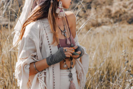 beautiful stylish young countryside woman on the field close up