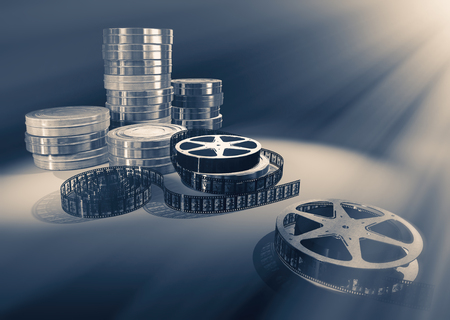 flick: Filmmaking concept scene with reels, tapes and dramatic lighting . Stock Photo