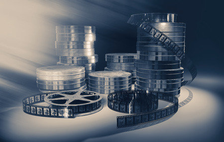 Filmmaking concept scene with reels, tapes and dramatic lighting . Stock Photo
