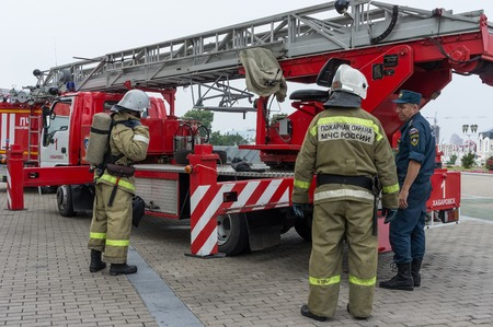 KHABAROVSK, RUSSIA, AUGUST 21, 2012: The firefighters are checking their equipment.