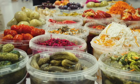 Plastic containers with pickled vegetables.