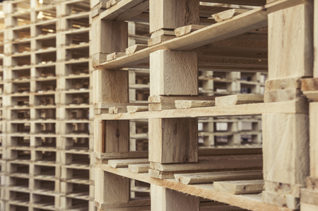 Stacked wooden pallets.