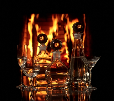 Glass vessels with vodka on a background a fire photo