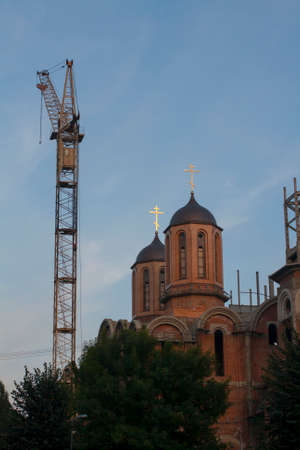 Construction crane on the construction of a the cathedral