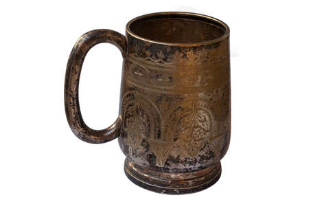 Old silver mug isolated. Shaded silver. Texture of silver sulfate on the surface of the cup.