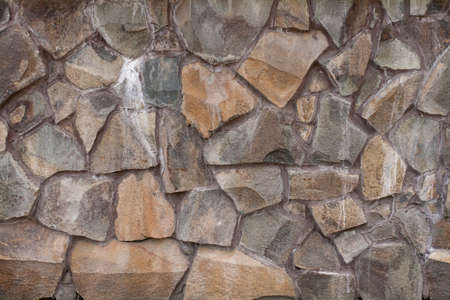 The texture of rough stone. Masonry from large boulders. Foundation. Building background.
