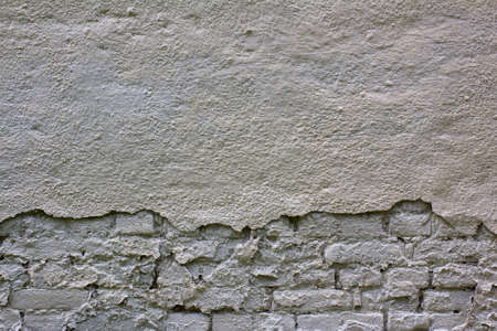 The texture of a rough brick wall painted white. Place for text.