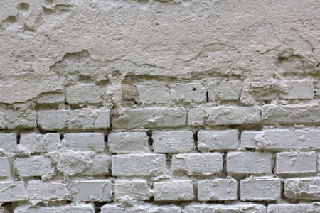 The texture of a rough brick wall painted white. Place for your text. Stock fotó
