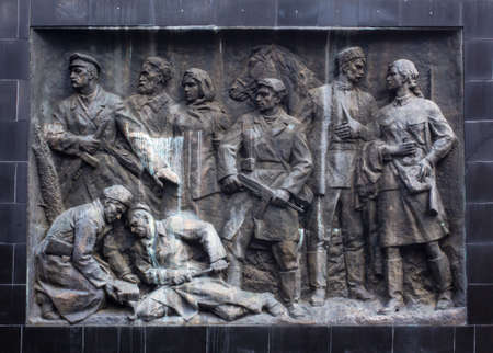 A sculptural composition in the style of socialist realism. A bas-relief of the times of the USSR on the theme of the Second World War.