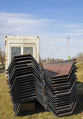 Steel construction pillars with specific shapes to stabilizes the flood protection dam