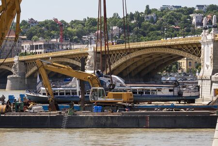 Budapest, Hungary – June 11, 2019; The end of the successfully raising action to the surface of the sunken Hableany tour ship lies on the barge.