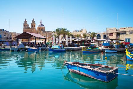 Marsaxlokk market with traditional colorful fishing boats Malta 스톡 콘텐츠