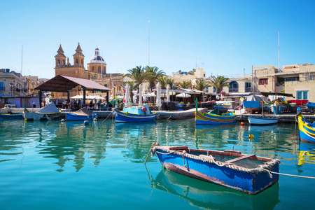 Marsaxlokk market with traditional colorful fishing boats Malta Stok Fotoğraf