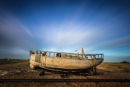 Wrecked ship with moving clouds at Dungeness beach, England, UK