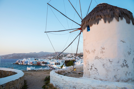 Famous Mykonos windmill at sunset, Greece