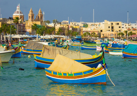 Traditional Luzzu fishing boats at Marsaxlokk market, Malta
