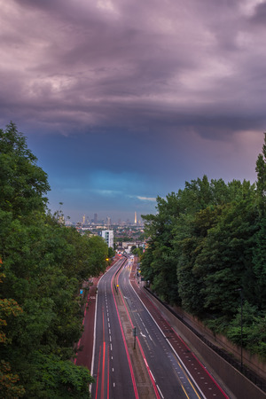 Sunset skyline of central London with storm clouds from Holloway Bridge, UK 版權商用圖片