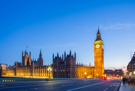 tower of london: The Big Ben with the Parliament from Westminster Bridge at blue hour, London, UK