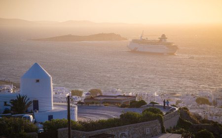 Sunset at Mykonos with windmills and cruise ship, Greece Reklamní fotografie